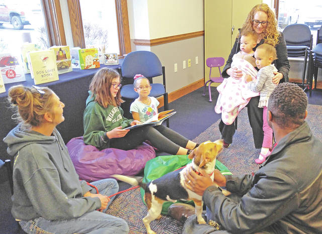 Patrons are pictured at the Fun at Reading with Rover Night held recently at the Greenfield Library.