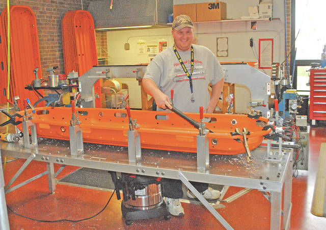 Highco Inc.'s Robert Bishop is pictured Wednesday afternoon working on a rescue bed for Ferno-Washington.
