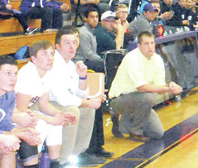 Jesse Mitchell, kneeling on the floor during a game this year, had his contract as McClain head boys basketball coach non-renewed Thursday by the Greenfield Board of Education.