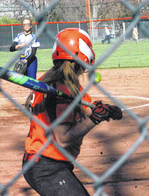 In this file photo the Lady Wildcats' Katie Ames prepares to swing at a pitch against the Manchester Lady Greyhounds at Whiteoak High School during the 2017 season.