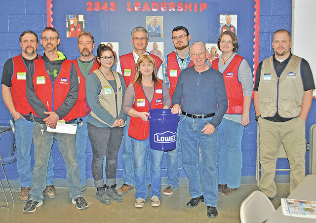 Greg Roberts (front row, far right) is pictured with Lowe's managers after the church where Roberts is a pastor and Lowe's teamed up to send 100 five-gallon buckets full of cleaning supplies to Ohio River flood victims. Pictured are (front row, l-r) Jeremiah Saylor, Amber Gorman, Amy Mitchell and Roberts; (back row, l-r) Andy Davis, Todd Davis, Roger Bowlby, Tyler Gray, Jen Fite and T.J. Whittington.