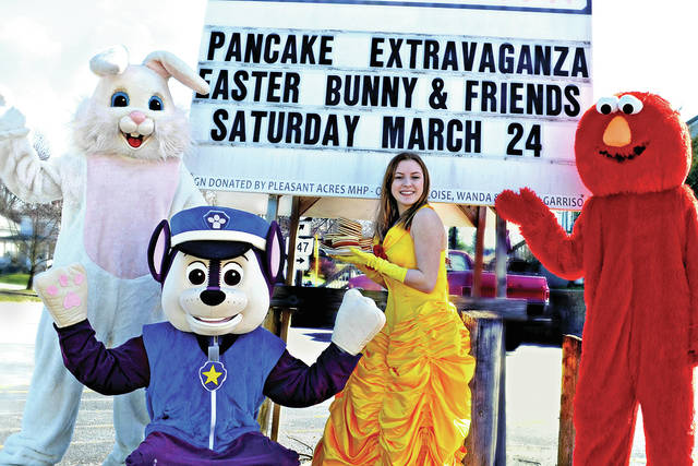 Characters that will be on hand for the annual Pancake Extravaganza with the Easter Bunny & Friends are pictured with a sign posted outside the Highland County Senior Citizens Center in Hillsboro.