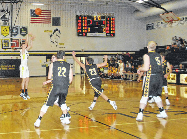 Eric McLaughlin shoots a jumper against the Paint Valley Bearcats at Lynchburg-Clay High School. McLaughlin was named to the Third team All-Ohio in Division III on Monday by the OPSWA.
