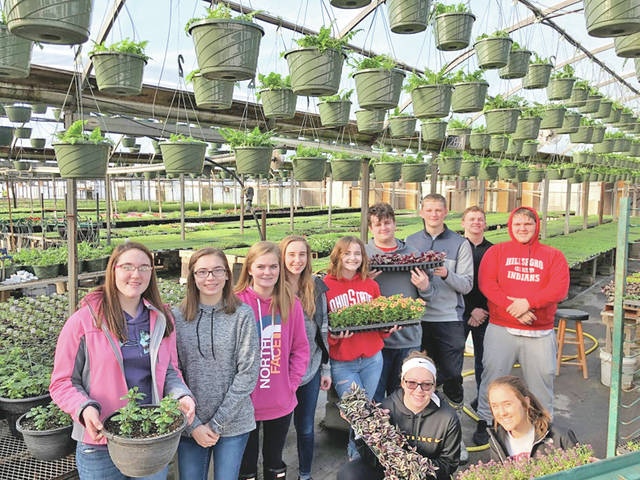 The Hillsboro FFA Greenhouse Management class recently took a field trip to Patchwork Gardens Greenhouses in Washington C.H. The chapter purchased plugs to plant in the greenhouse to sell during the annual flower sale in the spring. The students who attended were given a tour of the greenhouses where they were able to see how seeds are planted with various machines and the multiple stages they go through in order to germinate and grow. Toward the end of the visit the students were able to pick out additional plugs and flats that they think customers will like and they purchased them to take back to plant in the greenhouse. Every year the Greenhouse Management class goes to Patchwork to purchase plugs and the students always look forward to seeing how larger greenhouses operate in order to produce flowers that are sent all over the United States. Pictured are (front row, l-r) Jessica Moon and Kenzie Adams; (back row, l-r) Heather Burba, Hillary Hamilton, Kennedi Claycomb, Abby Roades, Attie Johnson, Kaleb Castle, Kole Maynard, Devon Gallimore and Tyler Annon.