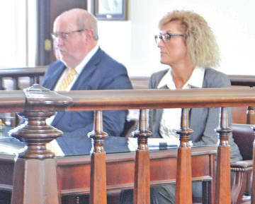 Former Highland County Commissioners clerk Rhonda Smalley, right, is pictured in court Thursday with her attorney, Bruce Wallace.