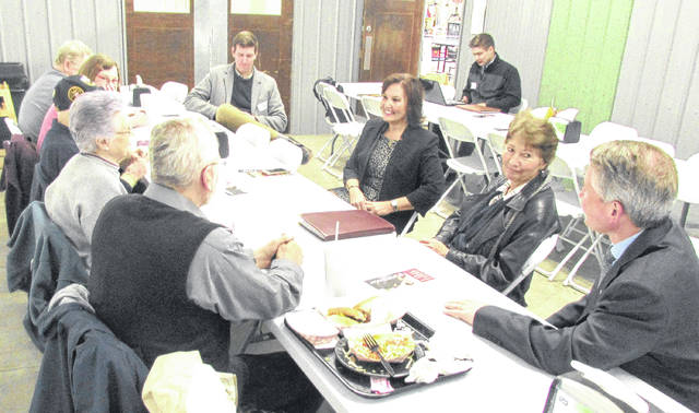 Ohio Lt. Gov. Mary Taylor, seated second from left, a Republican candidate for governor, and her running mate Nathan Estruth, foreground right, stopped in Hillsboro on Wednesday to talk with local residents about the 2018 GOP gubernatorial primary race.