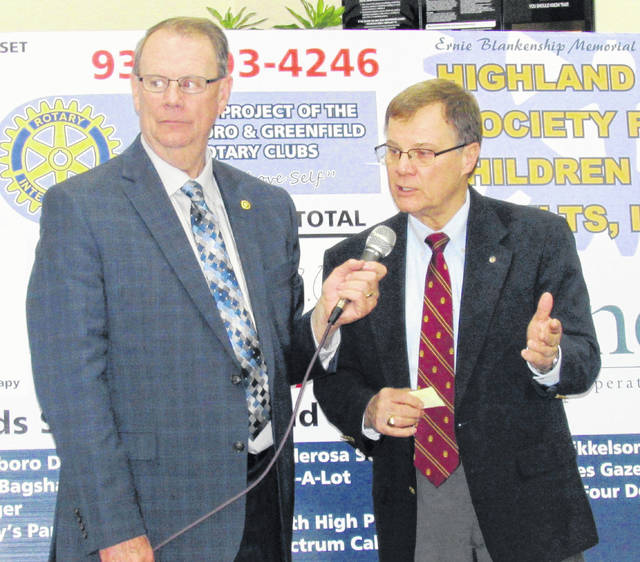 Highland County Common Pleas Judge Rocky Coss, right, a Hillsboro Rotarian who leads the fundraising drive for the annual radio-telethon for the Highland County Society for Children and Adults, is interviewed Wednesday night by emcee Rick Williams.