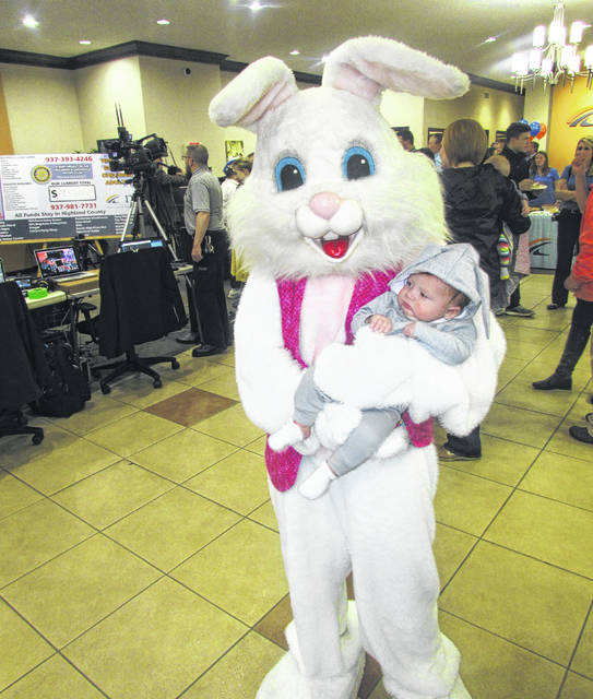 Four-month-old William Harris Jr., the son of William and Atlanta Harris, enjoys some cuddle time with the Easter Bunny during Wednesday night's radio-telethon at NCB Bank in Hillsboro.