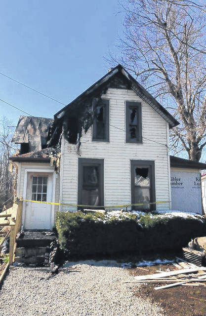 Shown is a Mowrystown home that was damaged by a fire last week. The local police department is accepting donations for the victims.