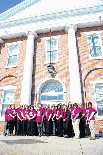 """A crowd of county employees gathers Thursday in front of the Highland County Courthouse wearing matching T-shirts in support of Chad Hodson, the son of Highland County Clerk of Courts Dwight """"Ike"""" Hodson, and a local basketball coach currently battling lung cancer."""