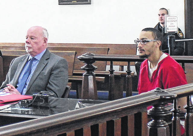 Kasey Wright, right, appears in court Monday for a plea hearing. Also shown is Wright's defense attorney, Bill Armintrout, seated at left.