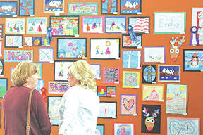 Guests enjoy the artwork on display at last year's Southern State Art Show.
