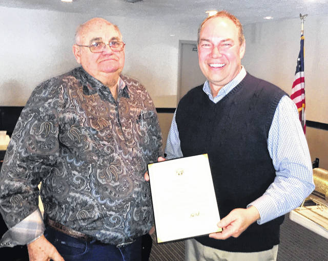 State Sen. Bob Peterson presented citations honoring Bill Butler of Union Stockyards (above) and local farmer Ken Davis at Tuesday's Hillsboro Rotary Club meeting. Davis' son, Evan, accepted the citation on his father's behalf.