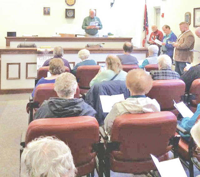 Greenfield Area Ministerial Association and community members are pictured during last year's National Day of Prayer observance in the Greenfield City Building.