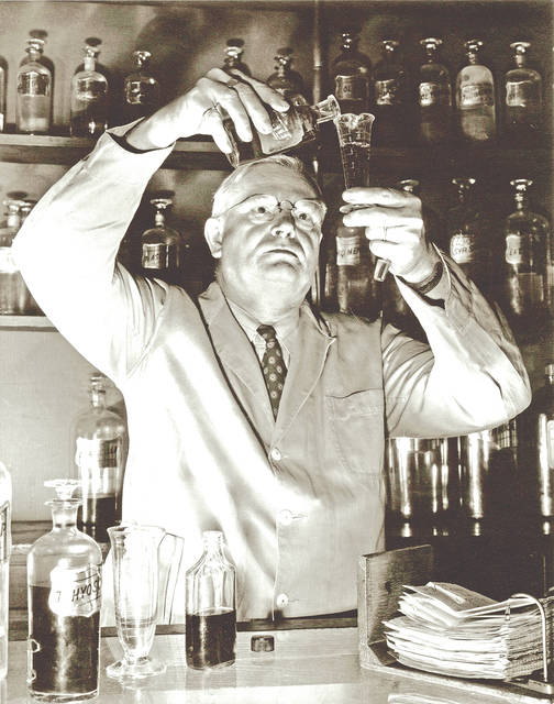 Late Hillsboro resident Ed Ayres is pictured in his pharmacy on East Main Street in the 1940s.