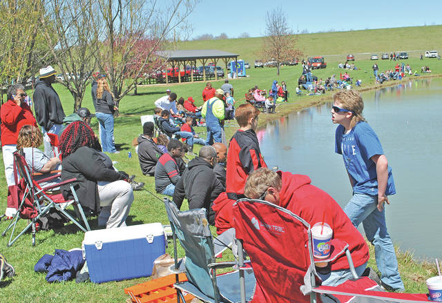 Part of the crowd that turned out for the City of Hillsboro Family Fishing Day a year ago is pictured at Harmony Lake in Liberty Park.