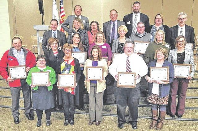 Pictured are (front row, l-r) Lisa Beresford, Margie Eads Walker, Stacy Camp, Jason Jones and Jennie Pierson; (second row) Doug Hauke, Shelly Bailey, Jennifer Updike, Melanie Ohnewehr, Kara Williams, Michael Snider, Kristin Unversaw and Mindy McCarty-Stewart; (third and fourth rows blended) Eric Wayne, Michael Bick, Maggie Lyons, Alana Walters, Tim Walters, David Lewis, Angela Godby and Rich Seas.