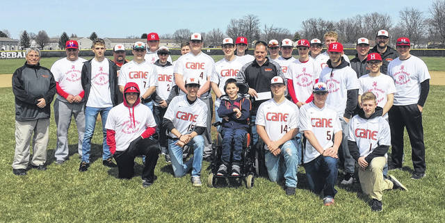 Coaches and players from the Hillsboro and Wilmington High School baseball programs pose for a picture on Sunday at Wilmington High School. The teams raised $1000 for the Little Hearts, Big Smiles Foundation.