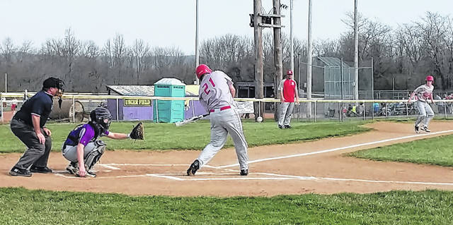 Hillsboro's Phillip MyCroft swings at a pitch in the second inning on Friday at Mitchell Park in Greenfield where the Indians battled the Tigers in FAC baseball action.