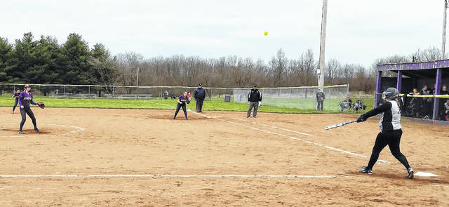Kyla Burchett (far left) and the Lady Tigers defense watches as the ball flies off the bat of a Miami Trace batter in the fifth inning of McClain's 7-6 win at Mitchell Park Friday.