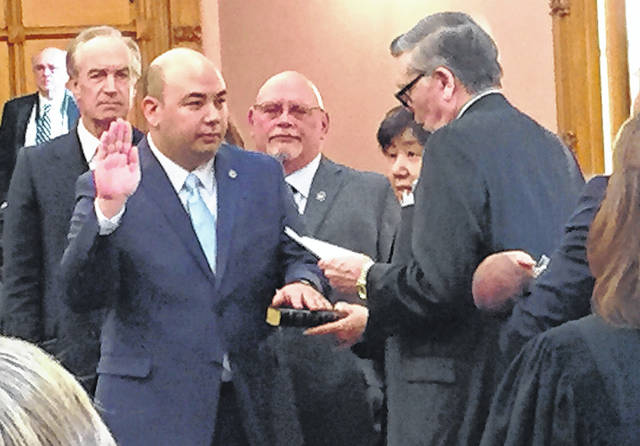 Ohio House Speaker Cliff Rosenberger is shown taking the oath of office in this file photo. Rosenberger announced his intention to resign May 1, but some lawmakers are suggesting he should step aside immediately.