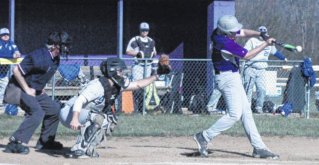McClain's Sam Faulconer makes contact with the ball in the second inning for a single at Mitchell Park on Friday as the Tigers battled the Chillicothe Cavaliers in FAC baseball action.