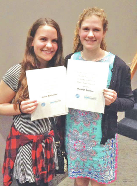 Grace Buchanan, left, and Shaleigh Duncan from Fairfield Middle School qualified for the state competition and also each earned a scholarship with the Ohio Tuition Trust Authority.