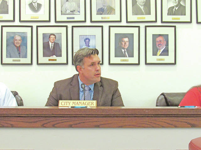 Greenfield City Manager Todd Wilkin delivers his first report to Greenfield Village Council at its meeting Wednesday.