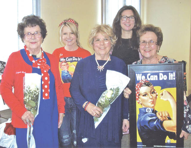 "Pictured from left, are Georgia Hufford, her granddaughter Paige Emling, daughters Scarlett Thomas and Janice Rogers, and sister Bess Hewitt, who is holding the famous Rosie the Riveter poster. Georgia said, ""They called the Rosies soldiers without guns."""
