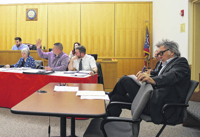 From left, Hillsboro City Council members Justin Harsha, Wendy Culbreath, Brandon Leeth and Adam Wilkin discuss business items during council's monthly meeting Monday at the Highland County Justice Center. Seated at right is Hillsboro Mayor Drew Hastings.