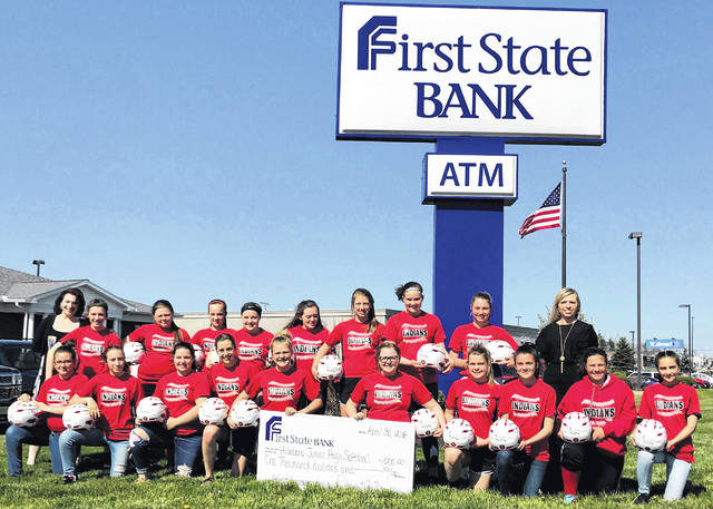 """The First State Bank team is pleased to announce the donation of $1,000 to the Hillsboro 7th & 8th grade Girls Softball team. The funds were donated in March and were used to help purchase new helmets for the team. On April 30, the entire team came to First State Bank for the official check presentation photo. The check was presented by Diana Grooms, Manager of the Hillsboro Banking Center. """"As a locally owned and operated bank, we believe in supporting our community schools"""", said Diana Grooms. """"We are a proud supporter of Hillsboro Athletics and we congratulate the girls on a great softball season,"""" said Grooms."""