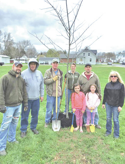 On April 28, the village of Lynchburg observed Arbor Day by planting eight trees in village parks. Five trees were planted along the creek at the covered bridge. River birch, crimson maple and bald cypress varieties were planted. Three trees – oak and shade master locust, were planted at Old School Park. The village extended thanks to all who came out on a cold, windy day to help. It offered special thanks to Mayor Terry Burden for use of his trailer and for picking up the trees. Pictured are some of the helpers: Nick Shaffer, Jamie Burton, Terry Burden, Chris Hamlin, Marty Bailey, and Addison, Brittany and Sandy West. Not pictured are Trudi Tedrick and Tristan Wilbanks.