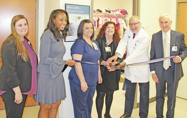 Pictured, from left, are Laurie Sturgell, Molina Healthcare; TaKeysha Cheney, director of community engagement for Molina Healthcare; Peggy Marcum, RN; Donna Collier-Stepp, Adena Women and Children's licensed independent social worker; M.D. Ronald Lopez, medical director, Baby Centered Recovery; and Jeff Graham, Adena president and CEO, cutting the ribbon to open Adena's new ABC Closet.