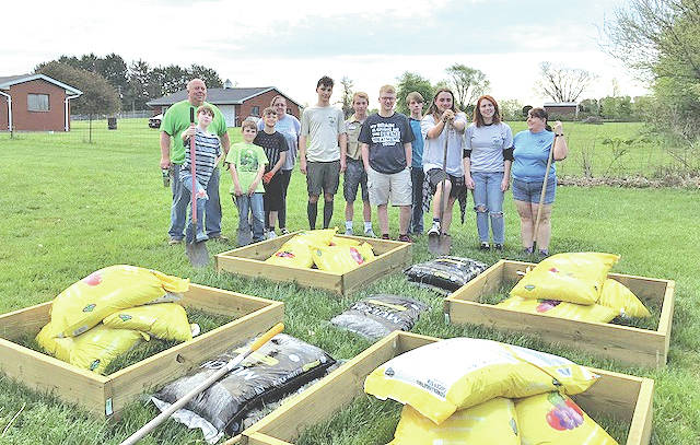 Members of Lynchburg Boy Scout Troop 120 are pictured with supplies fora community garden they constructed.