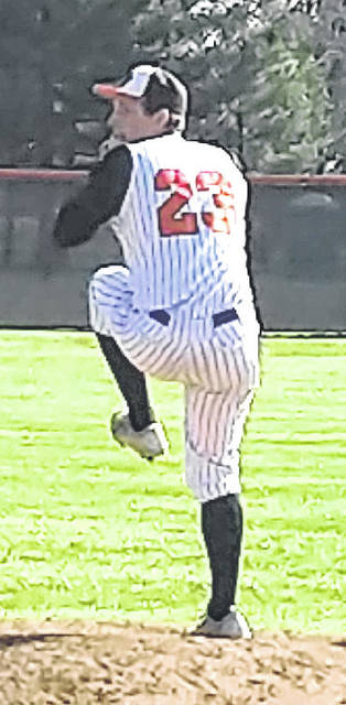 In this Times-Gazette file photo, Whiteoak starting pitcher Evan Brill winds up to throw a pitch against the Lynchburg-Clay Mustangs at Whiteoak High School.