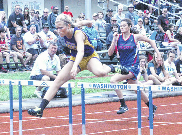 McClain's Chayden Pitzer clears a hurdle in the girls 100-meter hurdles race on Saturday in the finals of the Division II Girls Track and Field Tournament held at Washington High School.