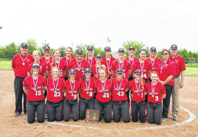 The Fairfield Lady Lions softball team poses for a team photo with their Division III District Championship medals and plaque on Sunday at Unioto High School following their 3-0 victory over Chesapeake.
