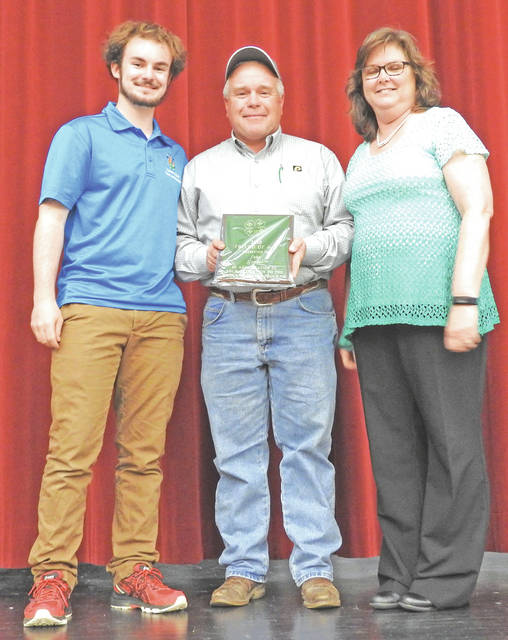John Grover (center) recently received a Friend of 4-H Award during the Member, Officer and Adviser Conference, along with Nikki Eyre and Steve Dillon. Grover has been involved in the 4-H program for many years including being part of the 4-H program as a youth. He is always willing to assist where needed. Many people know him from working the sale ring at the fair, auctioneering the Extension Fundraiser Dinner or as a dad to three individuals who have been and are involved in the 4-H program. Pictured are Cole Newsome, president of the 4-H Committee; Grover and Kathy Bruynis, 4-H educator.