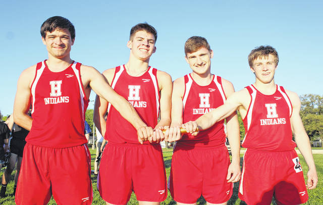 Hillsboro's FAC winning boy's 4x400-meter relay team poses for a picture at Washington High School on Thursday. Pitctured (l-r): Tyler Workman, Britton Haines, Mark Gallimore and Ty Alexander.
