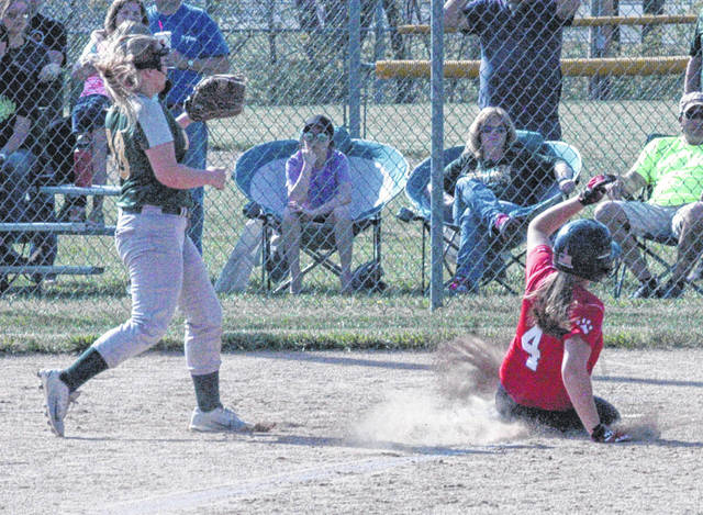 Fairfield's Layla Hattan slides into home on Tuesday at Fairfield High School where the Lady Lions took on the North Adams Lady Devils in a Sectional Semi-Final softball game.