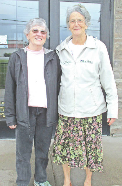 The Laurels of Hillsboro honored its most active volunteers during National Volunteer Week. Honored were Dick Kemp and Linda Kemp, who provide Sunday church services, Cathy Sader for playing the guitar and singing, and Carol Harless, a 16-year colunteer who is active in activities and various other departments. Pictured are Cathy Sader and Carol Harless.