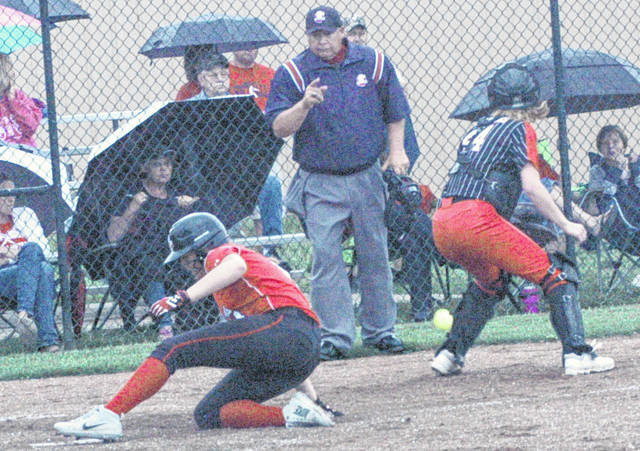Fairfield's Layla Hattan slides across home plate in the second inning on Friday at Unioto High School where the Lady Lions battled the Alexander Lady Spartans in the Division III Southeast District Semi-Finals.
