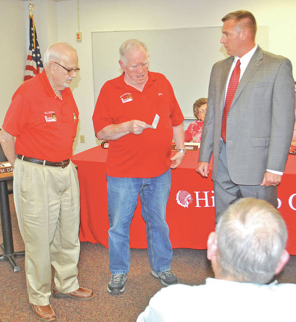Bob Parker, left, and John Dodds, center, present a check for $3,000 on behalf of the Hillsboro Lions Club to Hillsboro City Schools Superintendent Tim Davis at a Monday school board meeting. The money is to be used for the school libraries.