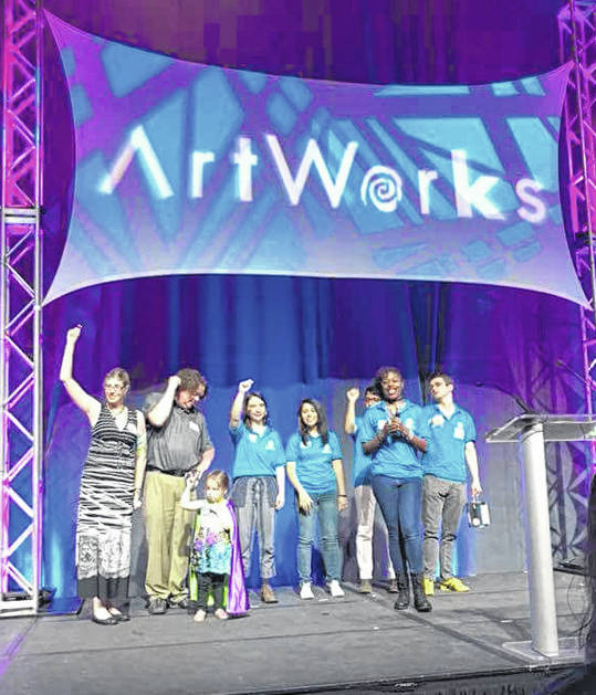 Four-year-old Ahna Freeman and her parents, Lauren Lutton-Freeman and Vernon Freeman, left, are pictured with ArtWorks staff last week at the Duke Energy Center in Cincinnati.