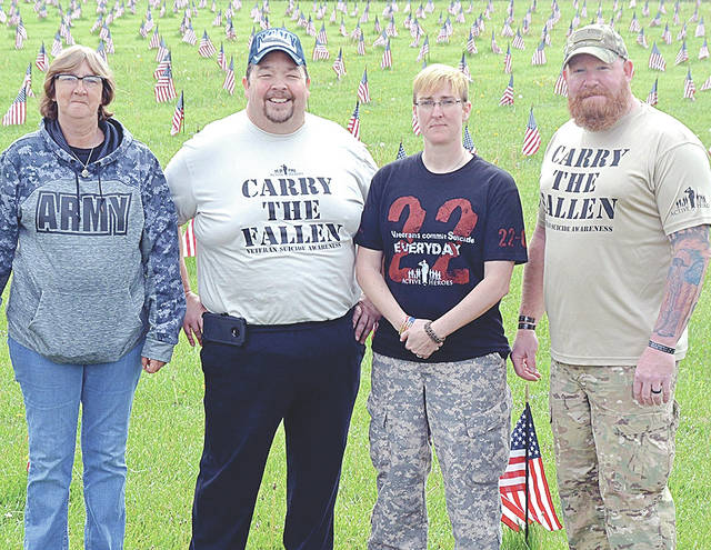 From left, Becky Williams with Support Our Troops of Highland County, Steve Witham with Active Heroes, Stephanie Roland with Support Our Troops of Highland County and Shawn Carter with Active Heroes are pictured at Saturday's event.