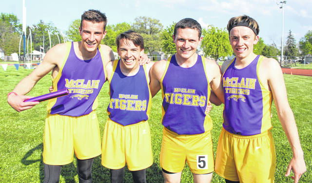 FAC-winning McClain 4 x 800-meter relay team poses for a photo at Washington High School on Tuesday. Pictured(l-r): Gabri Chiossi, Nathan Ernst, Trevor Newkirk and Reece Schluep.