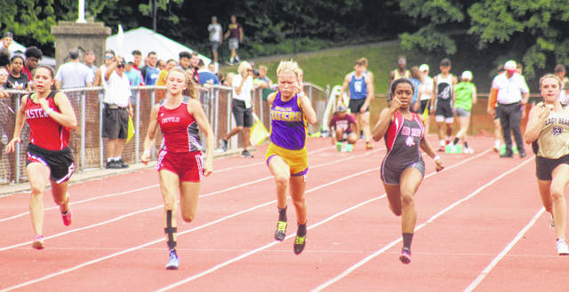 McClain's Chayden Pitzer, middle, competes in the finals of the girls 100-meter dash at the Regional track meet held at Muskingum University.