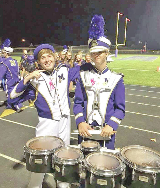 McClain High School junior-to-be Ricky Powell, right, is pictured at a Tiger football game last fall with fellow band member Dakota Bland.