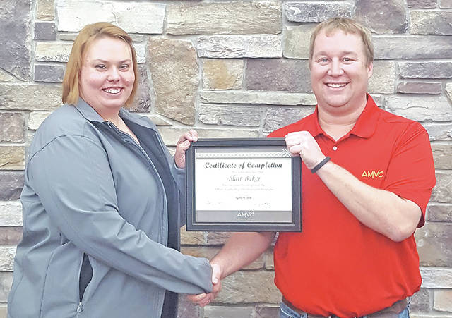 Blair Baker, left, is congratulated by Nick Weihs for completing the AMVC Leadership Development Program.