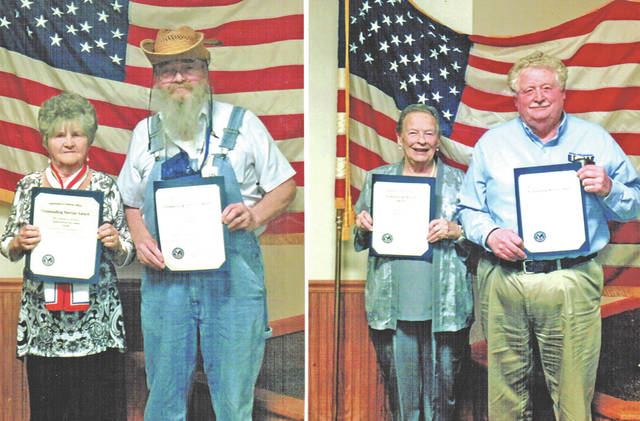 "The Chillicothe VA Medical Center recently recognized two local organizations during an event recognizing the center's volunteers and the organizations they represent. Pictured in the photo to the left are Luise Curtis and Gerald ""Buzzard"" Wilkin. Curtis was recognized for her work on behalf of the local AmVets Post 61 Ladies Auxiliary and Wilkin was recognized for his work on behalf of AmVets Post 61. The event had a farm theme, explaining Wilkin's attire. In the photo to the right are Mary Myers and John Knauff. Myers was recognized for her work on behalf of the Hillsboro VFW Post 9094 Auxiliary and Knauff was recognized for his work on behalf of Hillsboro AmVets Post 9094."